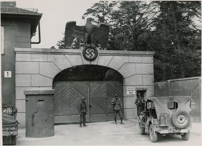 The former gates to the Nazi death camp Dachau during the Holocaust. The site of the camp is now helping address Europe's refugee crisis by housing refugees.Credit: National Archives Records of the Office of War Information via Wikimedia Commons.