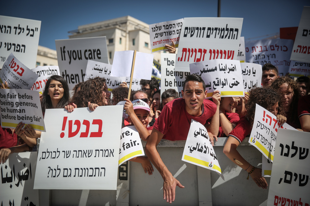 Click photo to download. Caption: Thousands of Christian students, teachers, and education workers protest in front of the Prime Minister's Office in Jerusalem on Sept. 6, 2015. Forty-seven Christian schools in Israel went on strike from Sept. 1-27 over alleged discrimination in the national school budget process. Credit: Flash90.