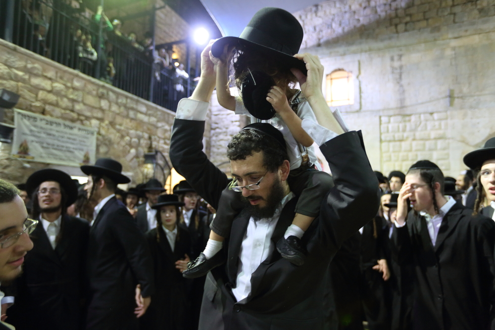 Click photo to download. Caption: Jewish worshippers at the Breslov Hasidic synagogue in Tzfat, Israel. The Breslov synagogue is among the unique spots in the northern Israeli city to celebrate Simchat Torah. Credit: Yaakov Naumi/Flash90.