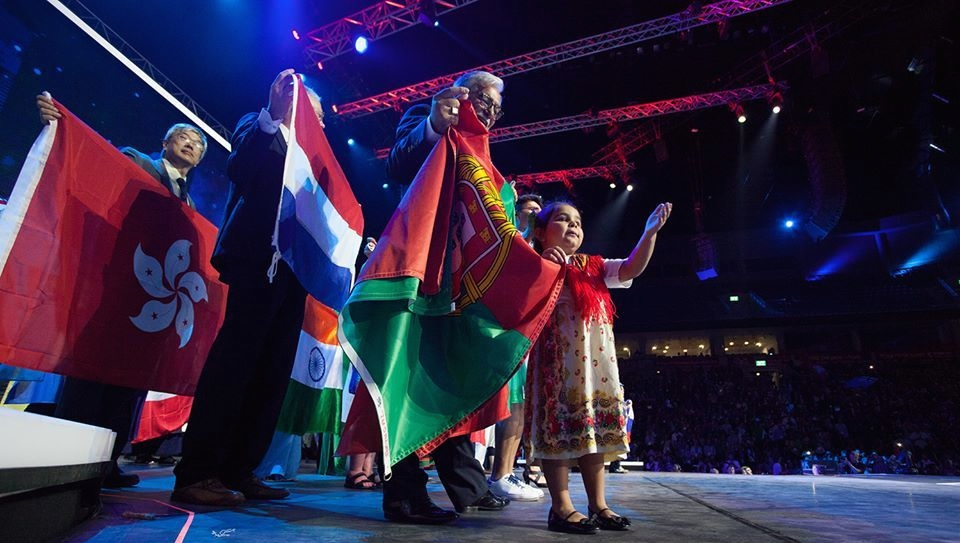 Click photo to download. Caption: International flags are showcased by delegates at this year's Feast of Tabernacles celebration in Jerusalem. Credit: ICEJ.