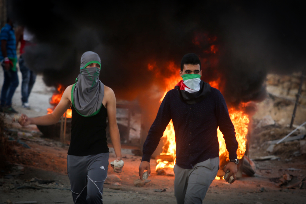 Click photo to download. Caption: A violent Palestinian riot on Sept. 30, 2015, near the Hezma checkpoint in the West Bank. Credit: Flash90.