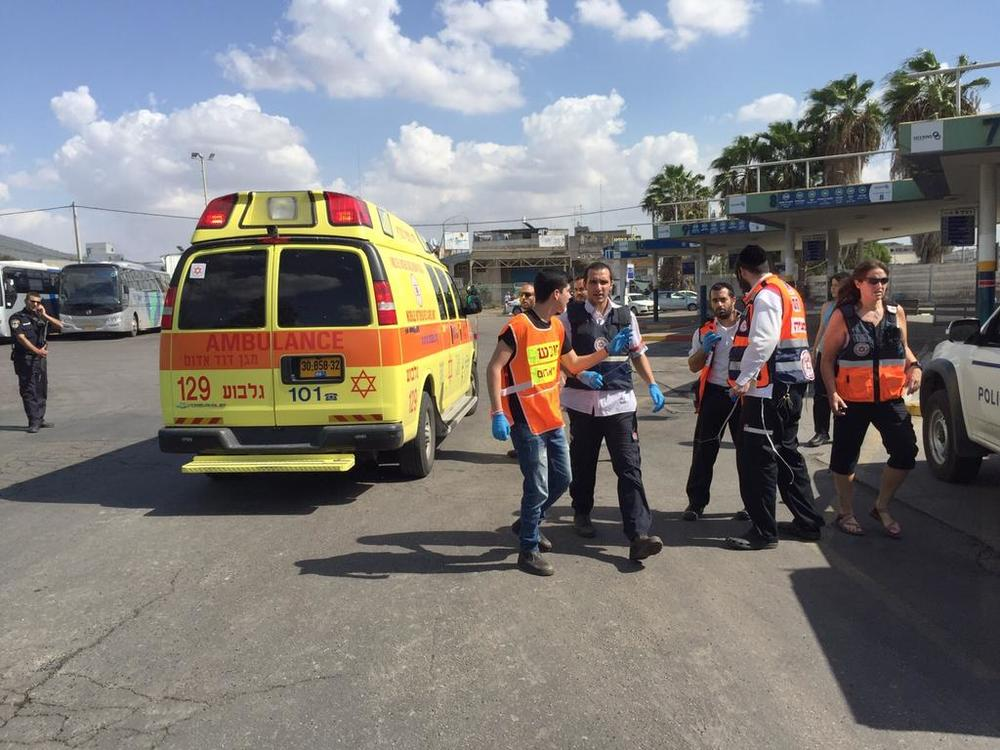 Magen David Adom emergency medical services personnel at the scene of Friday's attempted terror attack in Afula. Credit: Twitter.