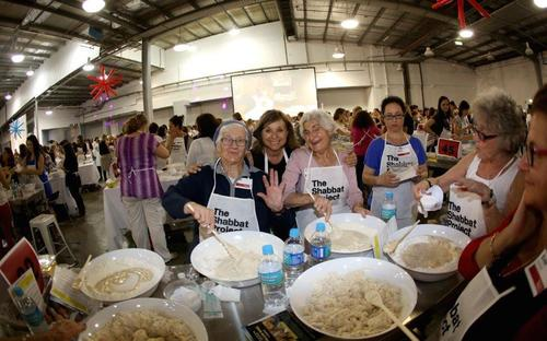 Click photo to download. Caption: Challah baking in Sydney, Australia, for The Shabbat Project in 2014. Credit: The Shabbat Project.