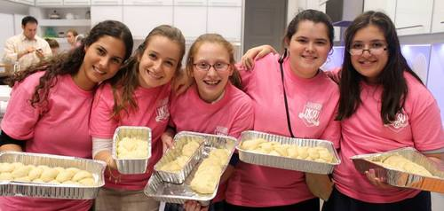 Click photo to download. Caption: Challah baking in Miami for The Shabbat Project in 2014. Credit: The Shabbat Project.