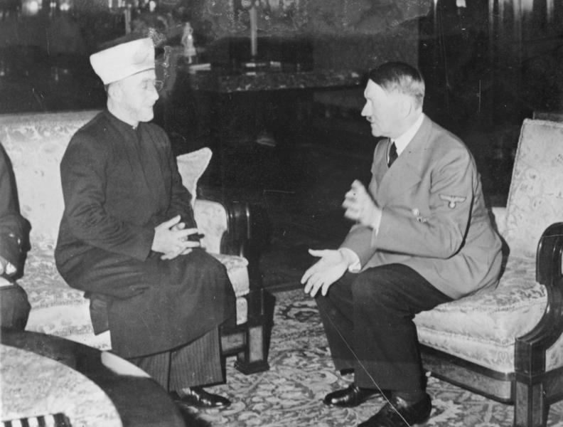 Click photo to download. Caption: The Mufti of Jerusalem, Haj Amin al-Husseini, meets with Adolf Hitler in 1941. Credit: German Federal Archives via Wikimedia Commons.