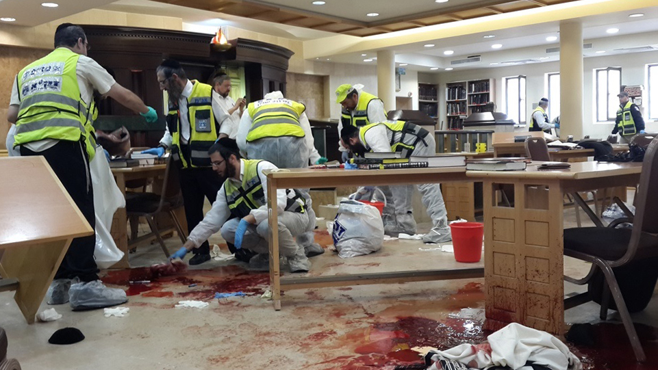 Click photo to download. Caption: On Nov. 18. 2014, Israeli ZAKA first responders at the site where two Palestinian terrorists entered the Kehilat Yaakov synagogue in the Jewish neighborhood of Har Nof, Jerusalem, with pistols and axes, and began attacking Jewish worshippers. Four Jewish worshippers were initially killed in the attack, and almost a year later, Rabbi Haim (Howie) Rothman also died from wounds he sustained that day. Credit: ZAKA Spokesperson.