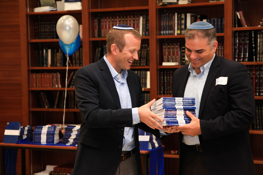 "Click photo to download. Caption: Rabbi Tuly Weisz (left) presents a set of ""The Israel Bible"" to Rabbi Avi Baumol. Credit: Israel365."