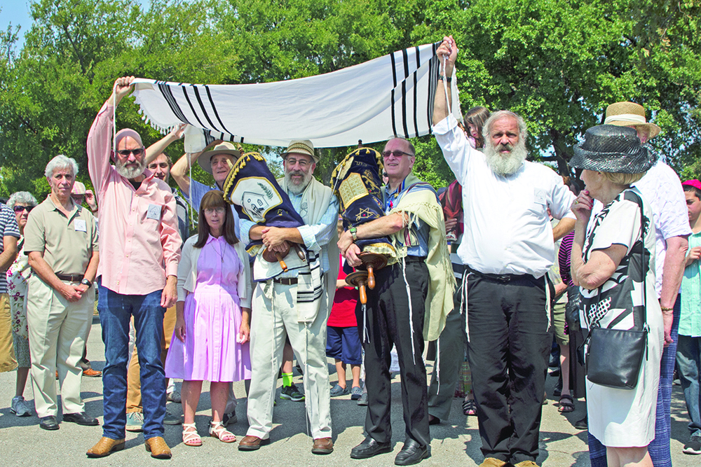 Click photo to download. Caption: The Torah scroll procession at the re-dedication of Brenham's B'nai Abraham Synagogue building—in Austin. Credit: Shalom Austin.