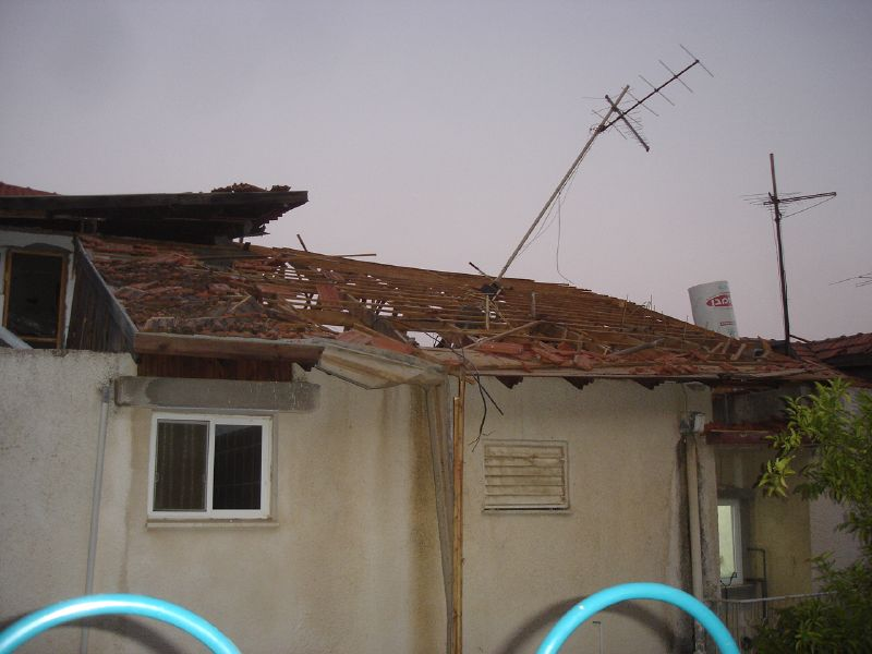 An Israeli home damaged by a Hezbollah rocket during the 2006 conflict. Credit: Wikimedia Commons.