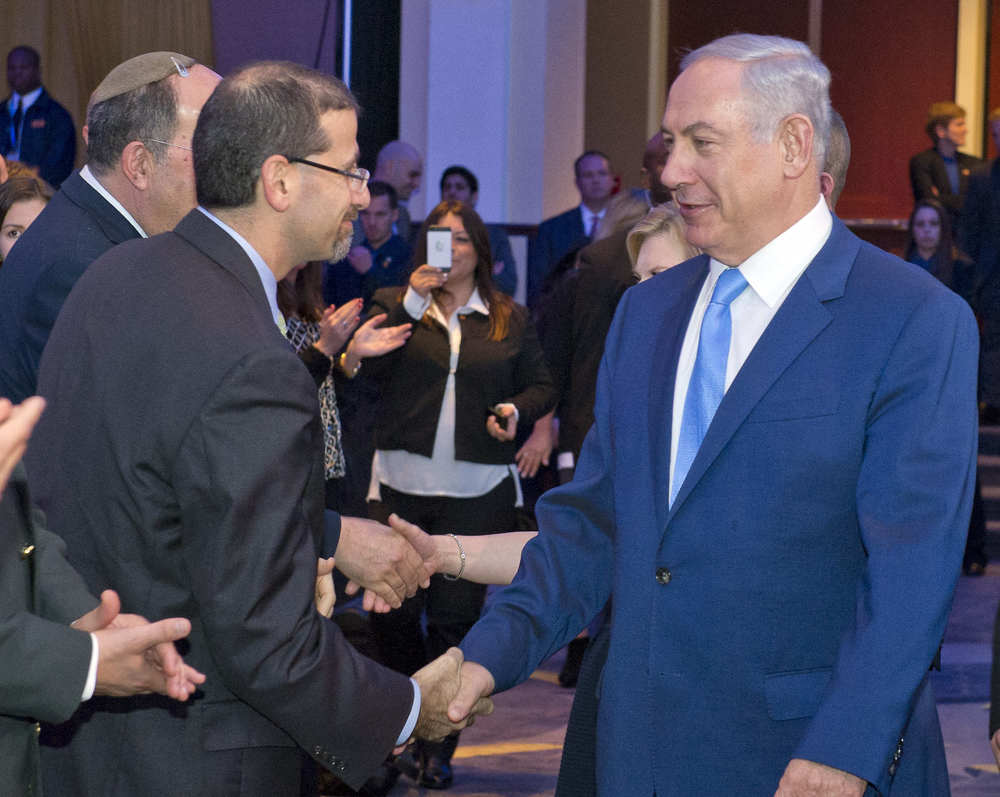 Click photo to download. Caption: U.S. Ambassador to Israel Daniel B. Shapiro (left) shakes hands with Israeli Prime Minister Benjamin Netanyahu on Tuesday at the Jewish Federations of North America General Assembly in Washington, DC. Credit: Ron Sachs.