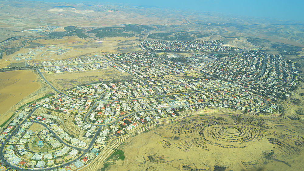 Pictured is Meitar, the intended destination of an Israeli family whose vehicle was attacked by a terrorist shooter on Friday. A father and son, ages 40 and 18, were killed. Credit: Wikimedia Commons.