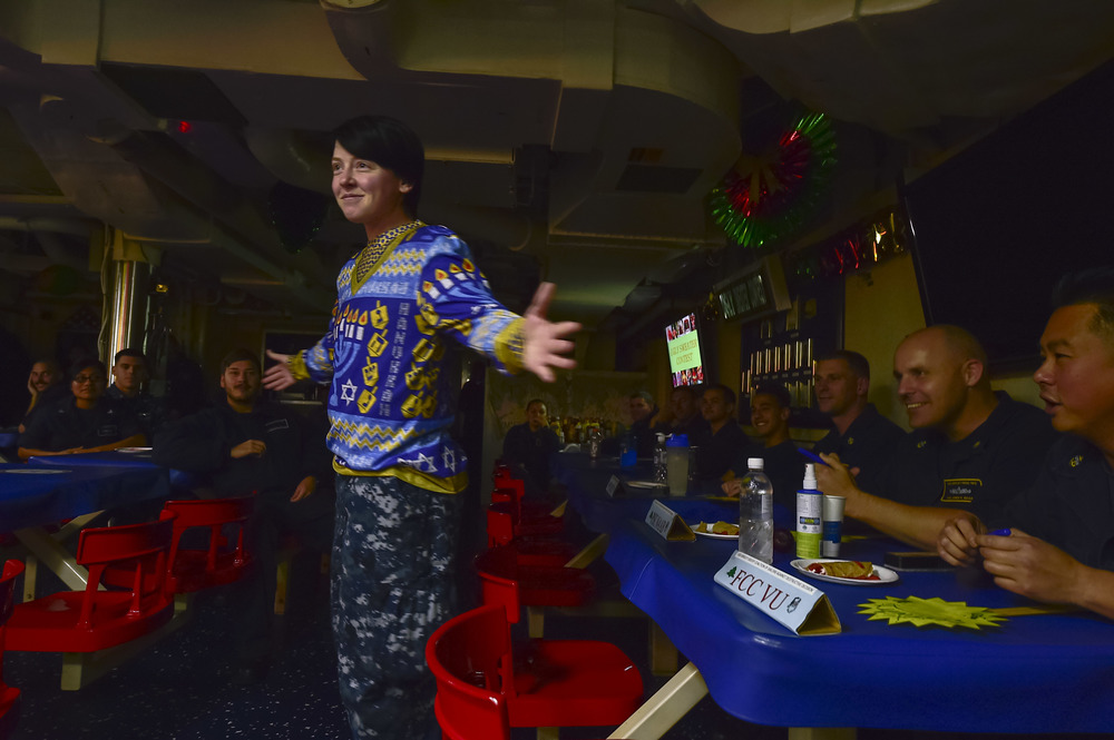 Cryptologic Technician (Maintenance) 2nd Class Eva MacFarland models a Hanukkah sweater during a Coalition of Sailors Against Destructive Decisions (CSADD) sponsored Ugly Holiday Sweater contest aboard guided-missile destroyer USS Gridley (DDG-101). Click photo to download. Caption: U.S. Naval Forces Central Command/U.S. Fifth Fleet.