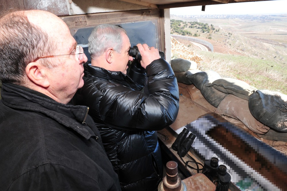 Click photo to download. Caption: Israeli Minister of Defense Moshe Ya'alon (left) and Prime Minister Benjamin Netanyahu (center, with binoculars) survey the Israeli-Syrian border in the strategically significant Golan Heights region on Feb. 18, 2014. Credit: Ariel Hermoni/Ministry of Defense/FLASH90.