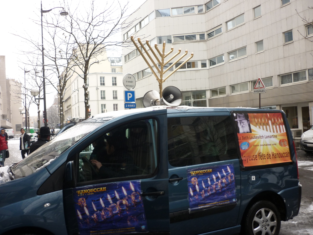 Chabad-Lubavitch activities for Hanukkah in Paris in 2009. Credit: Wikimedia Commons.