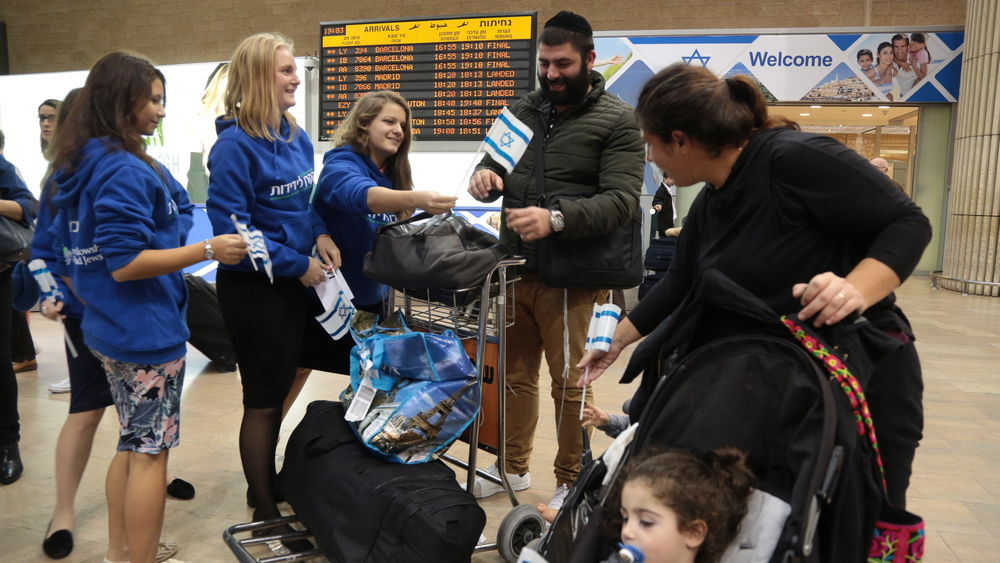 Click photo to download. Caption: On Nov. 16, days after the Paris attacks, the Ventura Family arrives at Ben Gurion Airport in Israel after moving out of France with the help of the International Fellowship of Christians and Jews. French Jewish aliyah has been on the rise and is now expected to experience a further uptick after the Paris attacks. Credit: Daniel Bar-On.