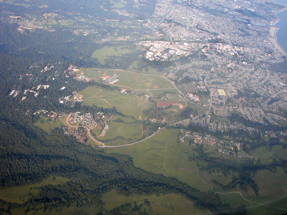 Click photo to download. Caption: An aerial view of the UC Santa Cruz campus and others areas in Santa Cruz, Calif. Credit: Doc Searls via Wikimedia Commons.