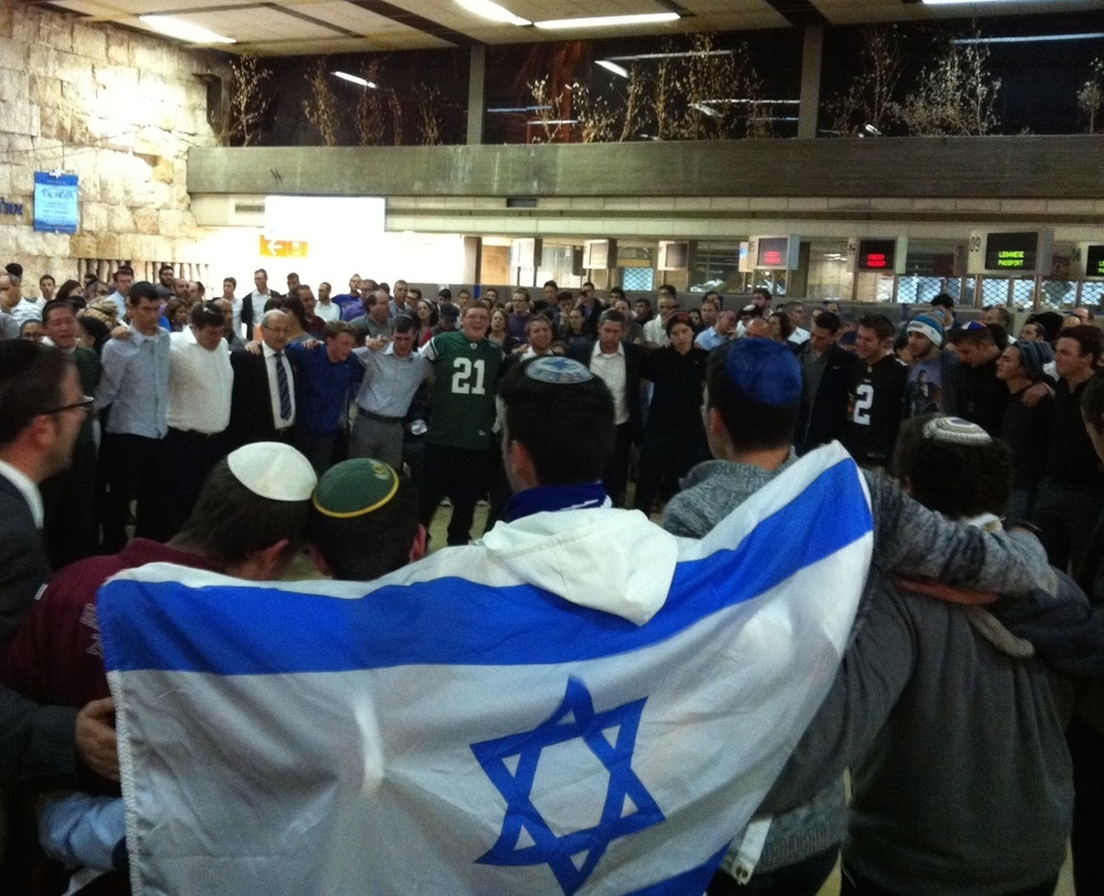 Click photo to download. Caption: Saturday night's farewell ceremony for Ezra Schwartz in the old Ben Gurion Airport building in Tel Aviv. Credit: Deborah Fineblum.