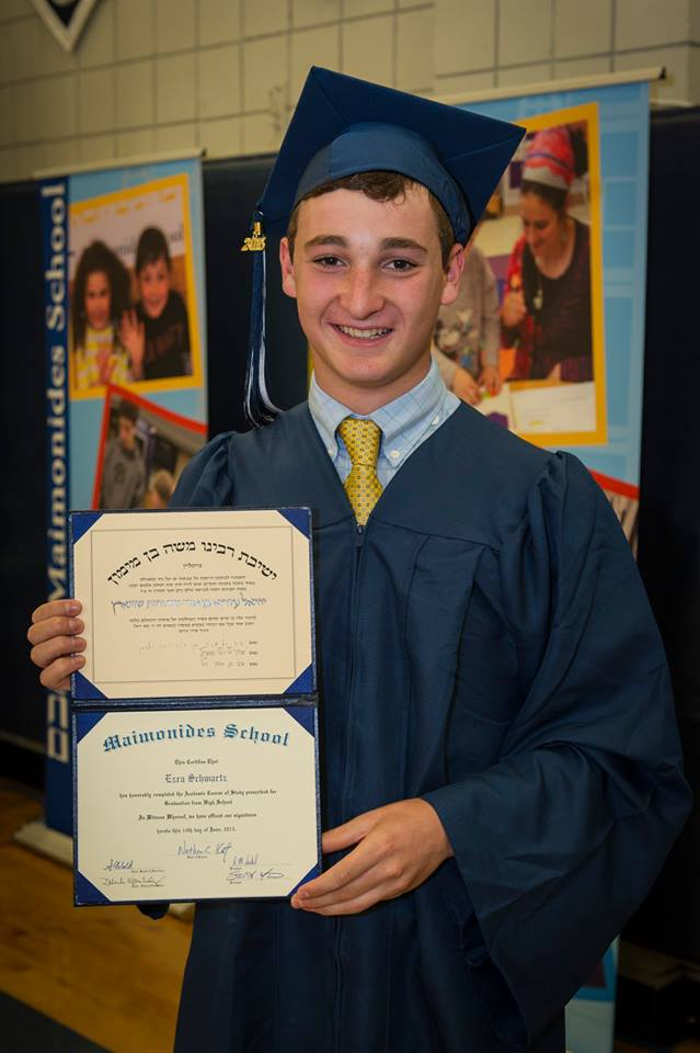 Click photo to download. Caption: Ezra Schwartz with his high school diploma from the Maimonides School in Brookline, Mass. Credit: Maimonides School via Facebook.