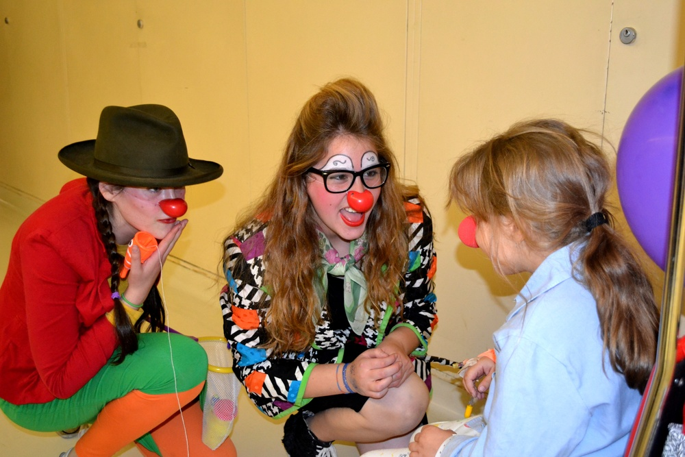 Click photo to download. Caption: Lev Leytzan medical clowns (at left and center) with a child patient. Credit: Courtesy Lev Leytzan.
