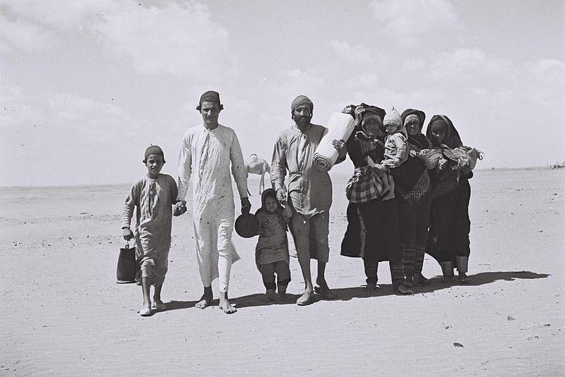 In 1949, a Yemenite Jewish family walks through the desert to a refugee camp set up by the American Jewish Joint Distribution Committee in the city of Aden. Credit: Kluger Zoltan - Israeli National Photo Archive.