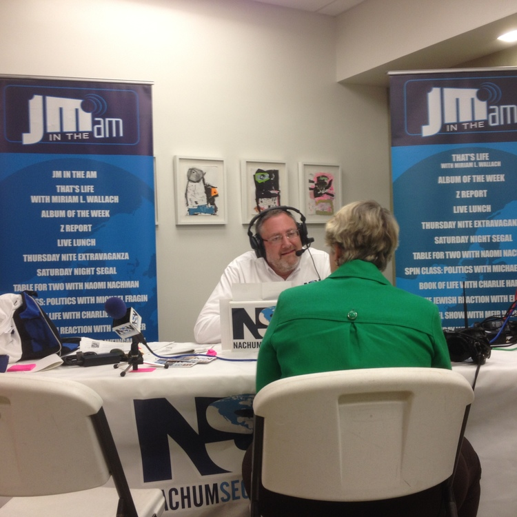 "Click photo to download. Caption: On July 7, 2015, Nachum Segal—host of the ""JM in the AM"" radio show—interviews the mayor of Houston, Annise Parker, at the Evelyn Rubenstein Jewish Community Center in that city. Credit: Jacob Kamaras."