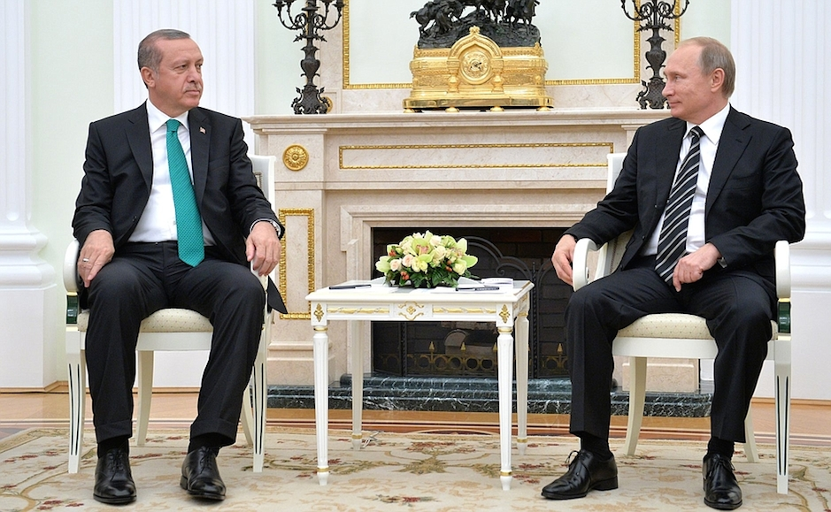 Click photo to download. Caption: Turkish President Recep Tayyip Erdogan (left) and Russian President Vladimir Putin meet in Russia on Sept. 23, 2015. Two months later, Russia-Turkey tensions have flared over a Turkish fighter jet shooting down a Russian fighter jet near the Turkey-Syria border on Nov. 24. Credit: The Presidential Press and Information Office via Wikimedia Commons.