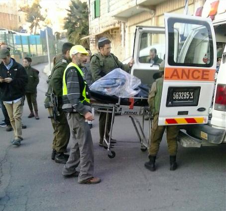 Israeli ZAKA volunteers at the scene of Monday's stabbing attack in Hebron. Credit: Courtesy ZAKA.