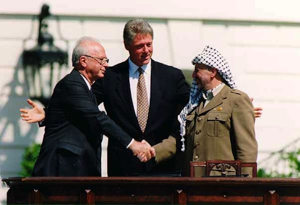 Yitzhak Rabin, Bill Clinton, and Yasser Arafat at the signing of the Oslo Accords—an agreement intended to bring about Israeli-Palestinian peace—on Sept. 13, 1993.Credit: Vince Musi/The White House.