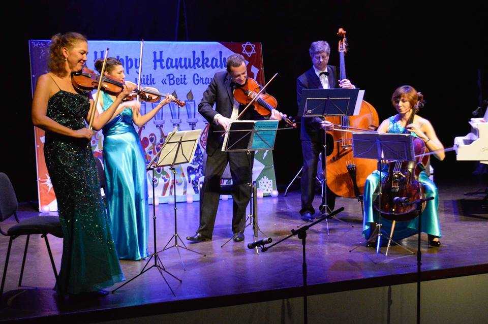 Click photo to download. Caption: Musicians entertain Jewish community members, including Hesed social welfare center clients, at the American Jewish Joint Distribution Committee's (JDC) Beit Grand JCC Hanukkah concert in Odessa, Ukraine. Credit: JDC.