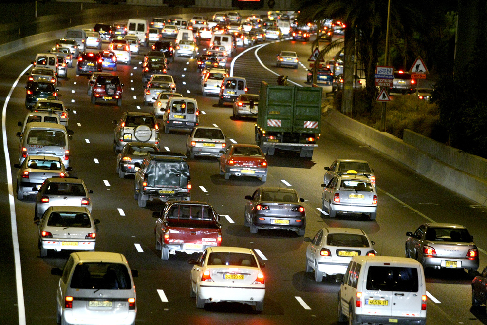 Click photo to download. Caption: A traffic jam on Israel's Ayalon Highway, near the entrance to Tel Aviv. Credit: Moshe Shai/Flash90.