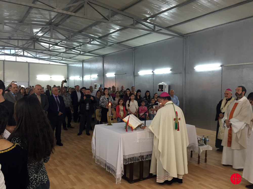 The inauguration of the chapel in Baghdad's Virgin Mary refugee camp. Credit: Aid to the Church in Need.