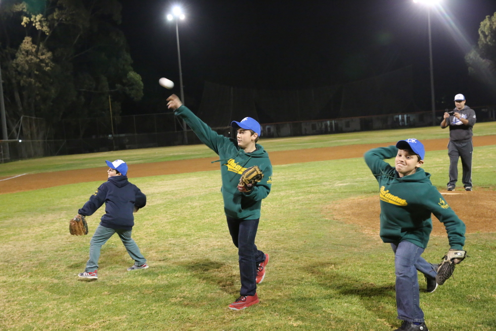 Click photo to download. Caption: Ezra Schwartz's younger brothers—Avi, Elon, and Hillel—throw out the first pitch at an Israeli baseball game on Dec. 29. Credit: Courtesy JNF.