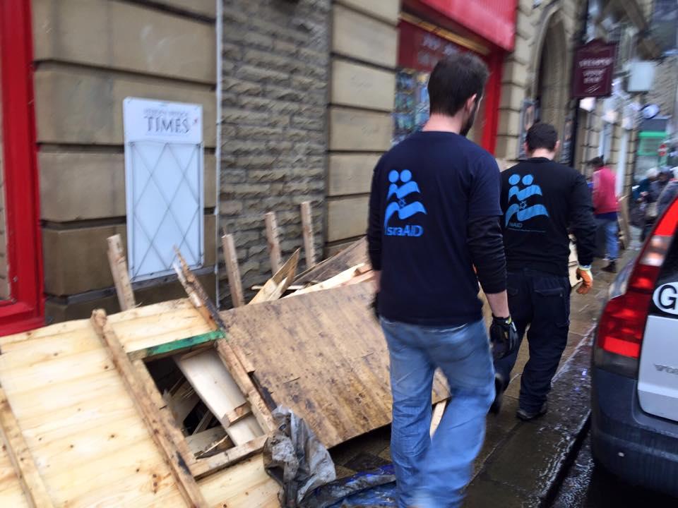 IsraAID volunteers provide flood relief in the U.K.Credit: IsraAID via Facebook.