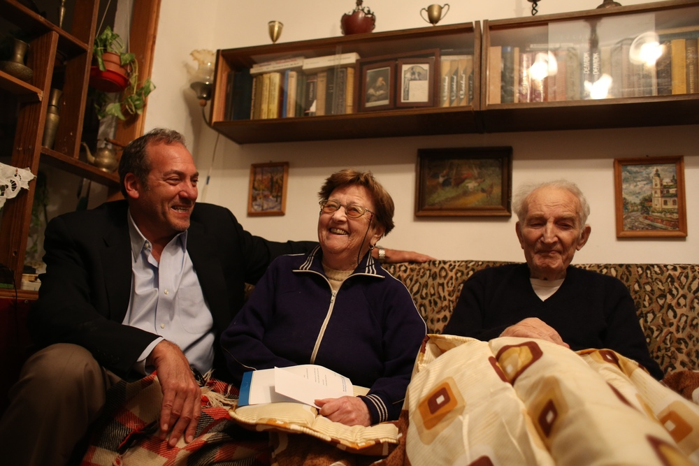 Click photo to download. Caption: In Israel, Rabbi Yechiel Eckstein (left) meets with Nalya and Lev Slobidker, immigrants from the former Soviet Union and recipients of aid from a food program of the Eckstein-led International Fellowship of Christians and Jews. Credit: Courtesy International Fellowship of Christians and Jews.