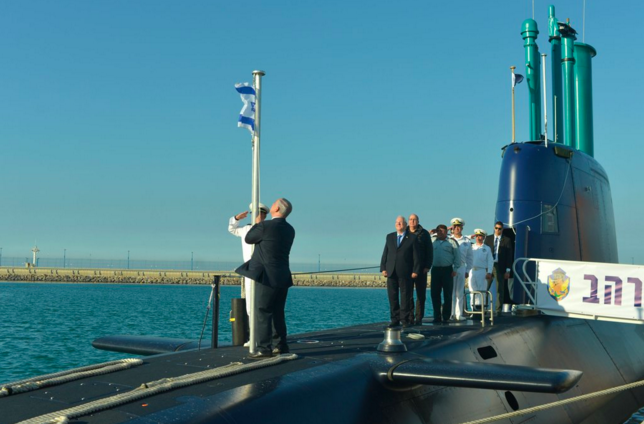 Prime Minister Benjamin Netanyahu raises the Israeli flag aboard the Jewish state's newest Dolphin-class submarine, the INS Rahav. Credit: PM of Israel via Twitter.