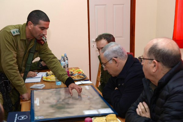 Israeli Prime Minister Benjamin Netanyahu strategizes with defense officials while visiting Otniel. Credit: Amos Ben Gershom/GPO.