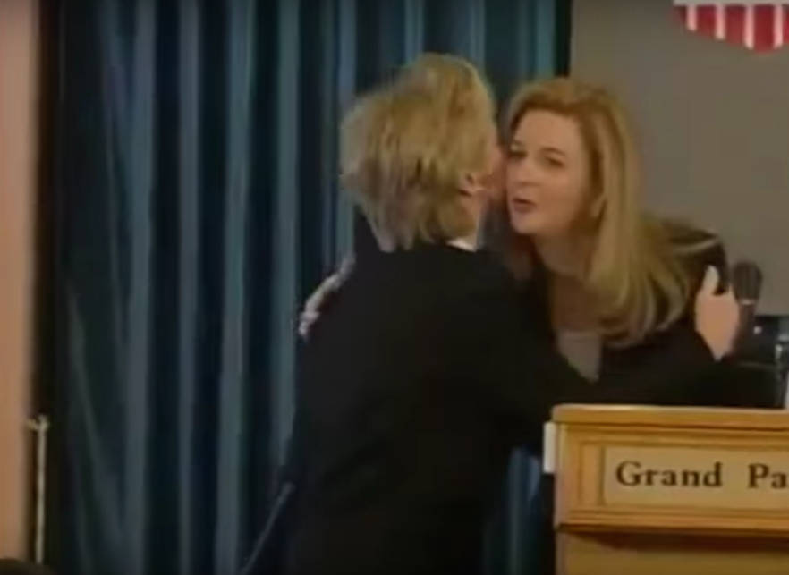 Click photo to download. Caption: The controversial embrace between first lady Hillary Clinton and Suha Arafat, Palestinian leader Yasser Arafat's wife, in Ramallah in 1999. Before receiving a kiss on the cheek from Hillary, Suha had made remarks in which she openly accused Israel of poisoning the West Bank's water supply and land. Credit: YouTube.