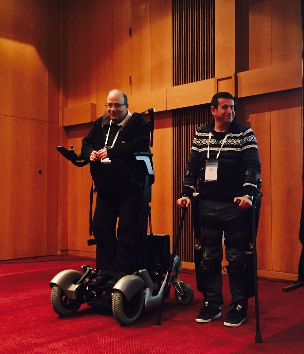 Click photo to download. Caption: Dr. Amit Goffer (left) uses the new UpNRide mobility solution for people bound to wheelchairs, while Radi Kaiuf uses the technology of ReWalk Robotics, at the OurCrowd Global Investor Summit in Jerusalem on Jan. 25. Credit: Maayan Jaffe-Hoffman.
