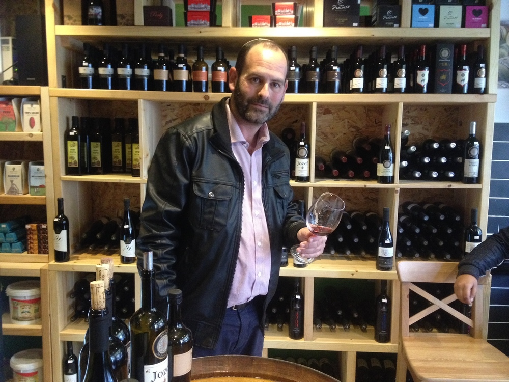 Click photo to download. Caption: Har Bracha Winery owner Nir Lavie at his soon-to-be-opened store in Tel Aviv. Credit: Orit Arfa.