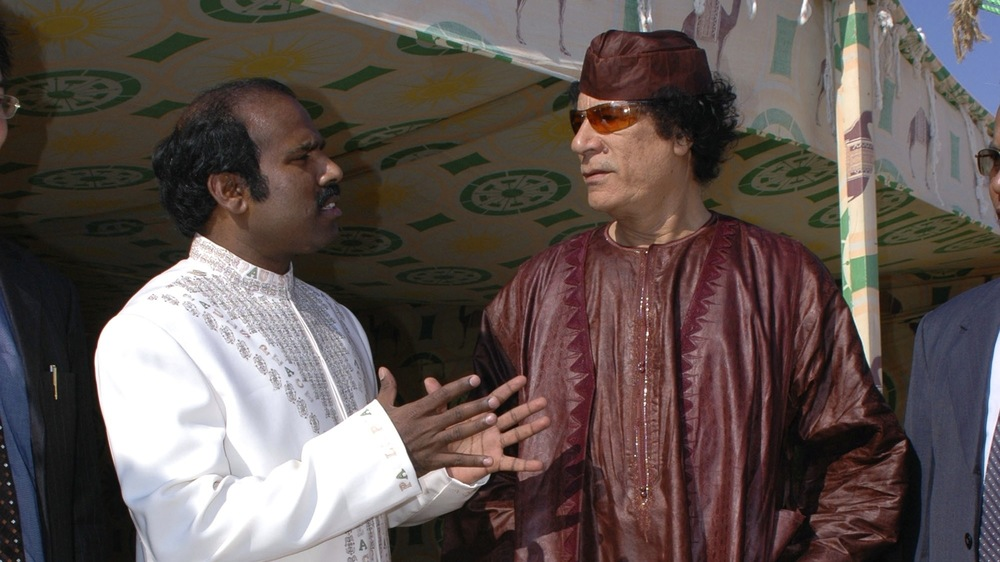 Click photo to download. Caption: Dr. K.A. Paul (left) with Libyan dictator Muammar al-Gaddafi. Credit: Courtesy of Global Peace Initiative.