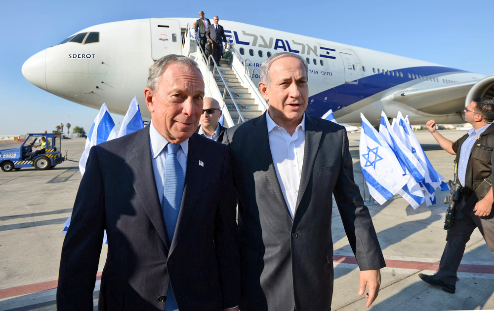 Click photo to download. Caption: Former New York City mayor Michael Bloomberg (left) is pictured with Israeli Prime Minister Benjamin Netanyahu as Bloomberg arrives in Israel on July 23, 2014. At the time, Bloomberg flew to Israel to take a stand against a U.S. Federal Aviation Administration ban on flights to the Jewish state. Credit: Haim Zach/GPO/Flash90.