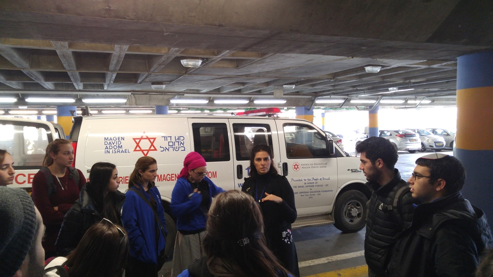 Click photo to download. Caption: During a recent mission to Israel, Yeshiva University and Stern College students learn about Israeli emergency medical services at Shaare Zedek Medical Center in Jerusalem. Credit: Yeshiva University.