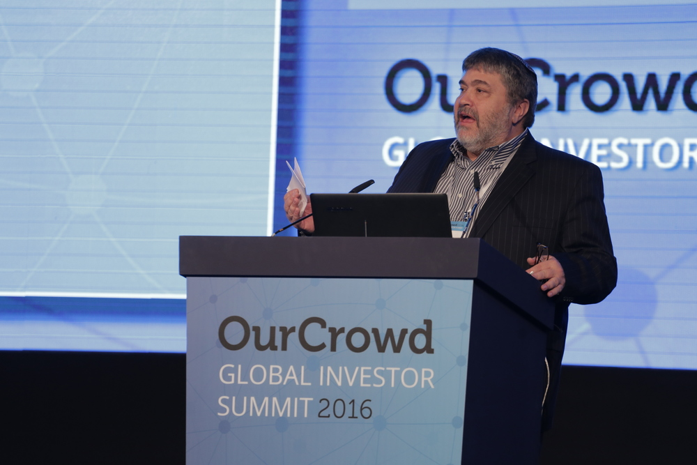 Click photo to download. Caption: Jonathan Medved—founder and CEO of OurCrowd, the leading global equity crowdfunding platform for accredited investors—speaks at the OurCrowd Global Investor Summit in Jerusalem. Credit: Courtesy OurCrowd.