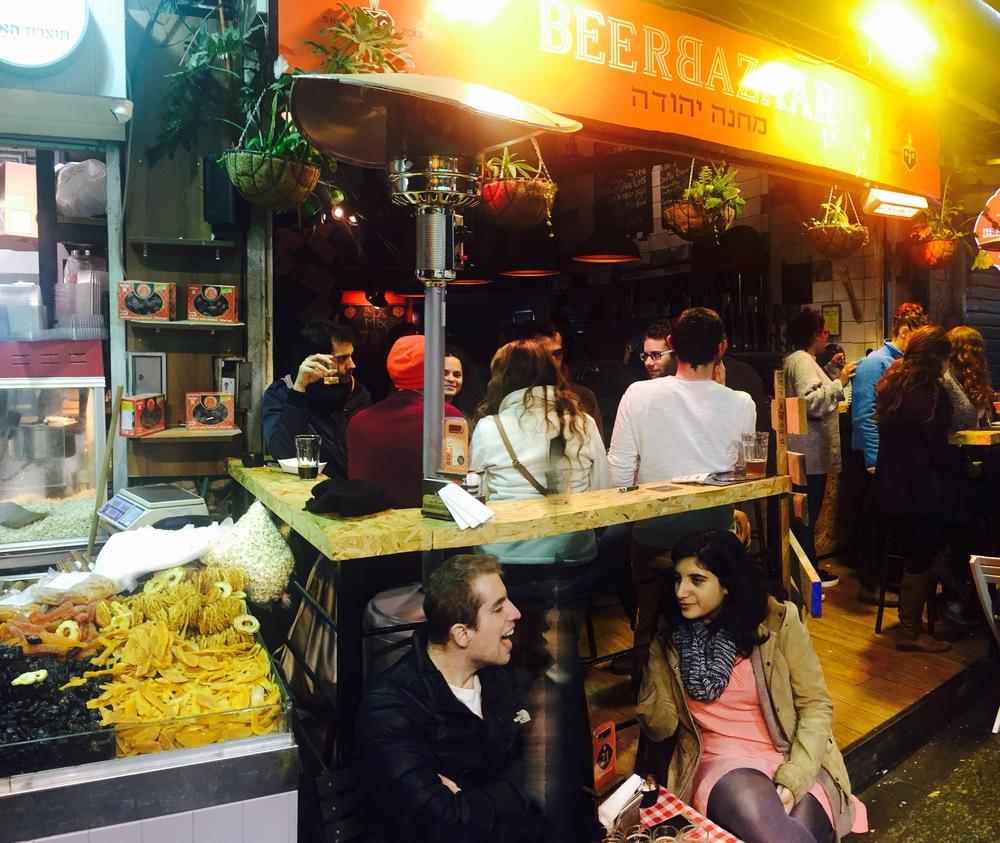 Click photo to download. The Beer Bazaar in Jerusalem's Shuk Mahane Yehuda. Credit: Maayan Jaffe.