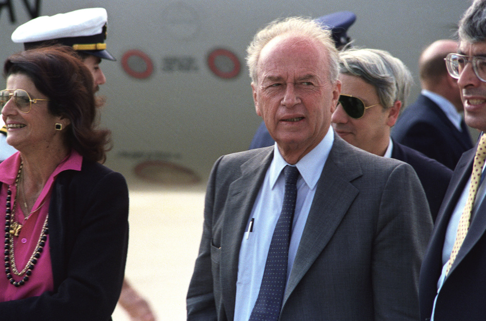 Click photo to download. Caption: Yitzhak Rabin (center), then the Israeli defense minister, arrives in the United States at Andrews Air Force Base, Maryland, in September 1986. Credit: Sgt. Robert G. Clambus via Wikimedia Commons.