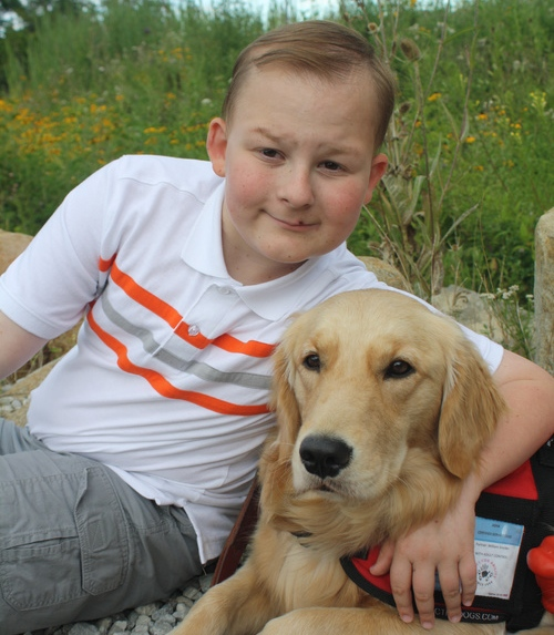 Click photo to download. Caption: William Snyder and his service dog, Asha. Credit: Courtesy Snyder family.