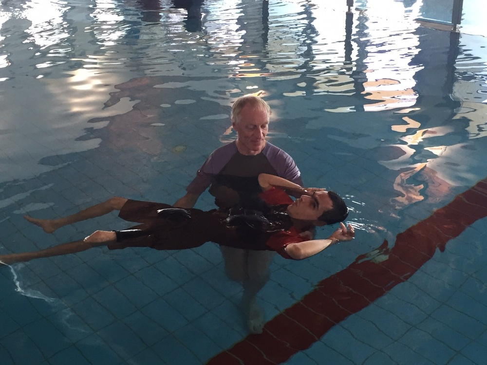 Click photo to download. Caption: Peter Von Brockhausen helps Elad Sair swim at the Aleh Negev-Nahalat Eran rehabilitation village in southern Israel. Credit: Courtesy Jewish National Fund.