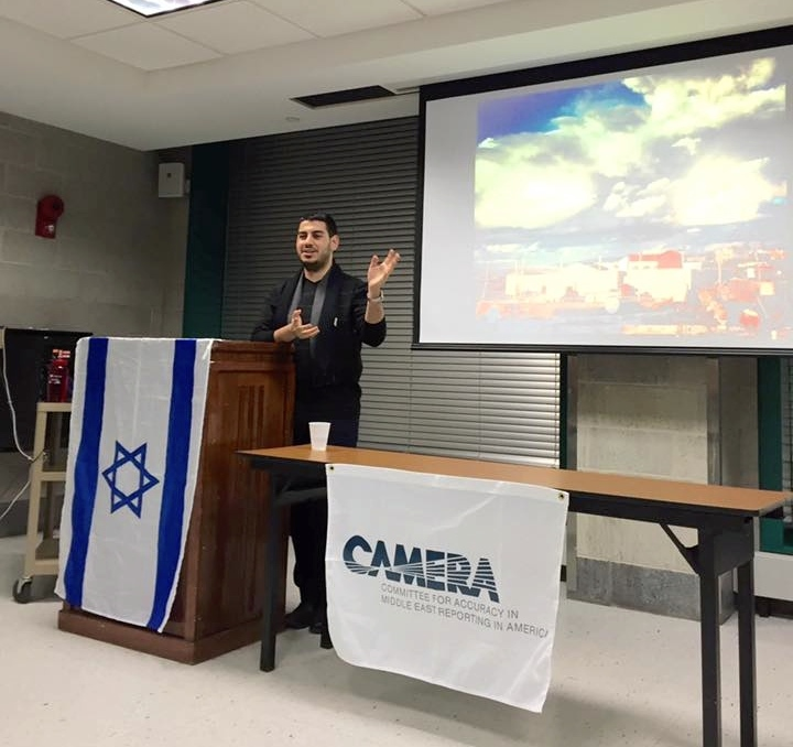 Click photo to download. Caption: Jonathan Elkhoury, a Lebanese refugee living in Israel, speaks at State University of New York, Binghamton, on Feb. 8. Credit: Courtesy CAMERA.