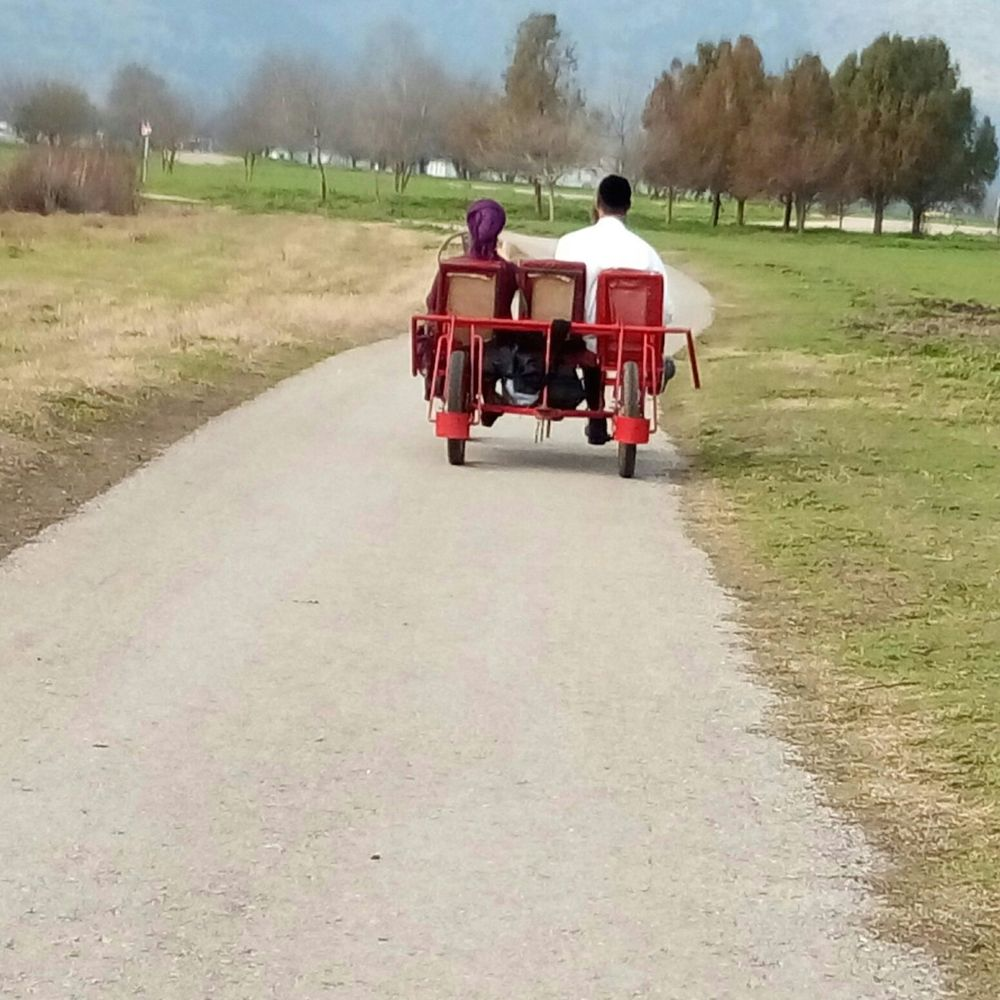 Click photo to download. Caption: Maya and David Stern ride a two-person bicycle around the path bordering Hula Lake. Credit: Courtesy JNF.
