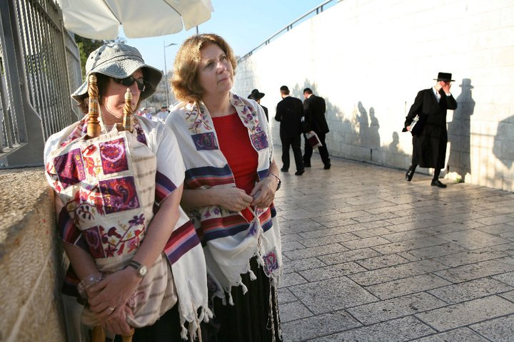 Click photo to download. Caption: Anat Hoffman (center) and another Women of the Wall member stand at the entrance to the Kotel. Credit: Michal Patelle via Wikimedia Commons.